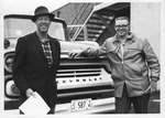 Two Men in Front of Delivery Truck by Concordia University - Portland